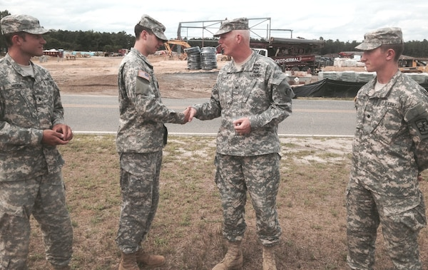 Army Cadet Intern Ryan Bunn. U.S. Army Corps of Engineers' New York District Commander Col. Paul Owen (second from right) greets Army ROTC Cadet Ryan Bunn, an intern from Gonzaga University, at Joint Base McGuire-Dix-Lakehurst in New Jersey during a site visit July 29, 2014. In summer 2014, cadets interned with the New York District through the Reserve Officers Training Corps' Cadet Troop Leader Training, providing a variety of leadership experiences prior to the senior year of college. At far left is Cadet Jacob Woicik (University of Wyoming); far right, Cadet James Oliver (University of Portland).