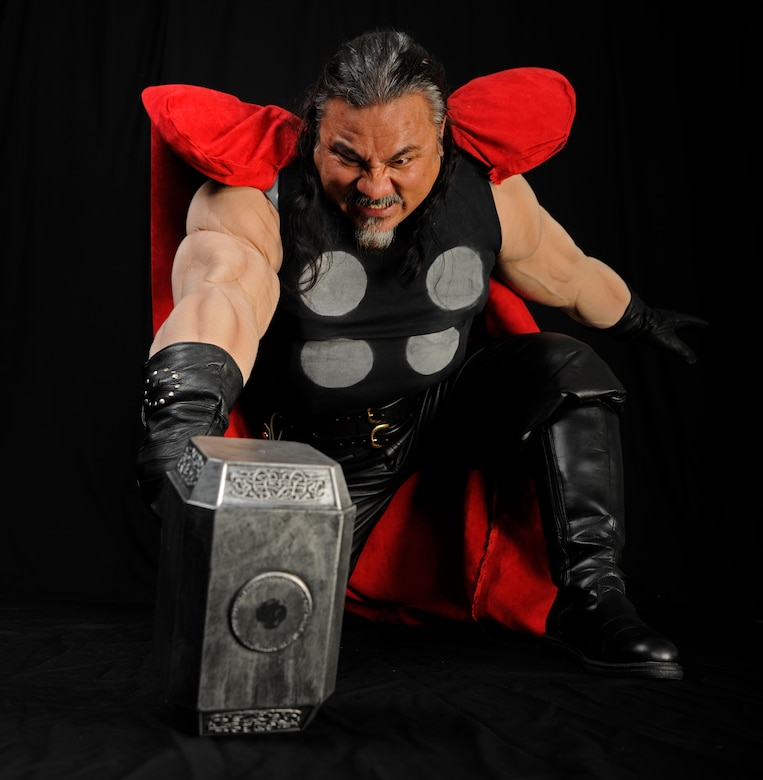 Randy Sena,11th Wing/Joint Base Andrews chief of exercises, strikes a blow for justice in a Thor costume he made himself.  And avid cosplayer, Sena has won several awards for his designs. (U.S. Air Force photo/Staff Sgt. Torey Griffith)