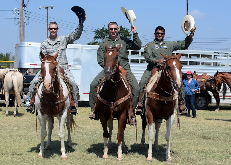 ALTUS AIR FORCE BASE, Okla. – Leaders of the 97th Air Mobility Wing sit horseback during the 16th Annual Altus AFB Cattle Drive, Aug 21, 2014. During the event, base leaders and rodeo staff members herd the cattle throughout the base for all to view. The cattle drive has become a precursor for the long-standing annual Great Plains Stampede Rodeo held in the City of Altus, Okla. (U.S. Air Force photo by Senior Airman Franklin R. Ramos/Released)