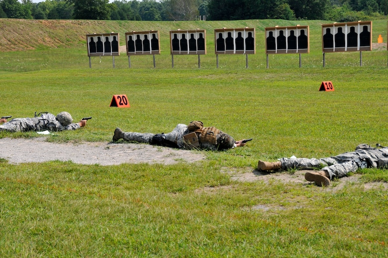 Members of the Tennessee Army and Air National Guard hone their shooting skills in the prone position with a Beretta M9 service pistol during a training session at the 2014 Tennessee Adjutant General Marksmanship Pistol Match in Tullahoma, TN on Aug 15. The Tennesee TAG Match is held anually to promote marksmanship skills in the Army and Air National Guard.  (U.S. Air National Guard photo by Master Sgt. Kendra M. Owenby, 134 ARW Public Affairs)