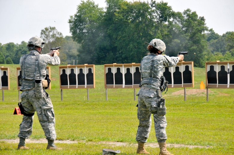Members of the Tennessee Army and Air National Guard hone their shooting skills with a Beretta M9 service pistol during a training session at the 2014 Tennessee Adjutant General Marksmanship Pistol Match in Tullahoma, TN on Aug 16. The Tennesee TAG Match is held anually to promote marksmanship skills in the Army and Air National Guard.  (U.S. Air National Guard photo by Master Sgt. Kendra M. Owenby, 134 ARW Public Affairs)