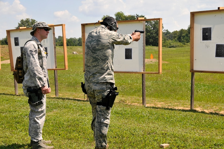 Staff Sgt. Scott Cavin (left), 134 ARW Security Forces Squadron Journeyman, serves as a range line safety for a fellow Airman at the 2014 Tennessee Adjutant General Marksmanship Pistol Match in Tullahoma, TN on Aug 15. The Tennesee TAG Match is held anually to promote marksmanship skills in the Army and Air National Guard. (U.S. Air National Guard photo by Master Sgt. Kendra M. Owenby, 134 ARW Public Affairs)