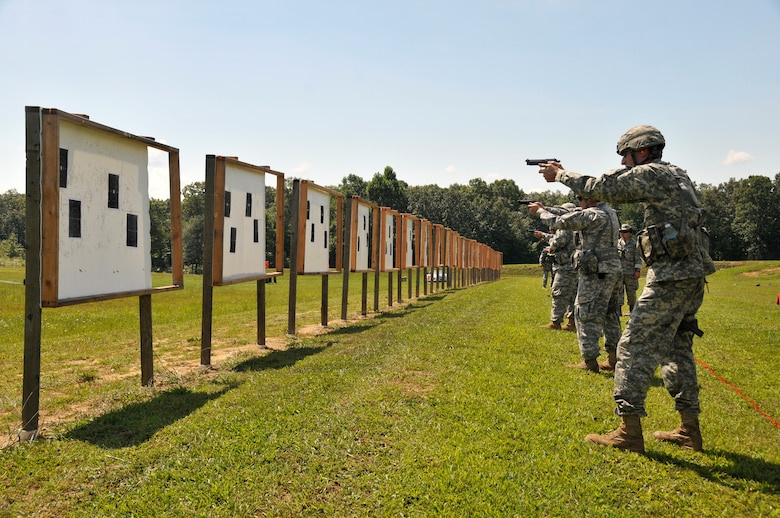Members of the Tennessee Army and Air National Guard practice thier target acquisition skills with a Beretta M9 service pistol during a training session at the 2014 Tennessee Adjutant General Marksmanship Pistol Match in Tullahoma, TN on Aug 15. The Tennesee TAG Match is held anually to promote marksmanship skills in the Army and Air National Guard.  (U.S. Air National Guard photo by Master Sgt. Kendra M. Owenby, 134 ARW Public Affairs)