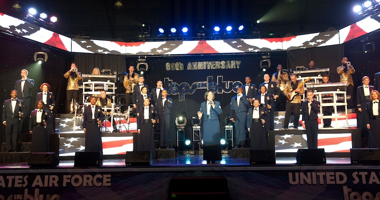 The entire U.S. Air Force Tops in Blue team sing during a performance Aug. 19, 2014, at the Wings Over the Rockies Air and Space Museum in Denver. Tops in Blue is the Air Force's premier entertainment showcase that tours around the world, performing in 20 countries and more than 70 locations in the United States each year. (U.S. Air Force photo by Airman 1st Class Samantha Saulsbury/Released)