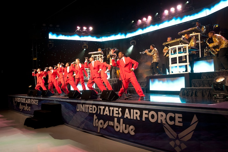 The men of U.S. Air Force Tops in Blue sing together during their performance Aug. 19, 2014, at the Wings Over the Rockies Air and Space Museum in Denver. Tops in Blue is the Air Force's premier entertainment showcase that tours around the world, performing in 20 countries and more than 70 locations in the United States each year. (U.S. Air Force photo by Airman 1st Class Samantha Saulsbury/Released)