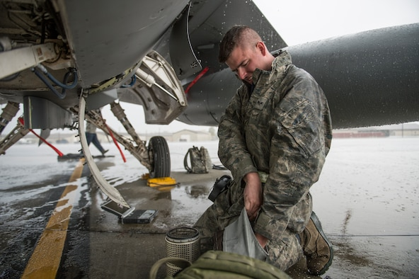 U.S. Air Force Senior Airman James Gunning, 8th Aircraft Maintenance Squadron electrical and environmental specialist assigned to Kunsan Air Base, South Korea, changes a water sock filter on an F-16 Fighting Falcon during RED FLAG-Alaska 14-3 Aug. 18, 2014, Eielson Air Force Base, Alaska. Gunning supported the aircraft which flew two sorties a day throughout the exercise. (U.S. Air Force photo by Senior Airman Peter Reft/Released)