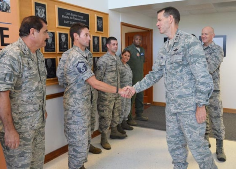 Director of the Air National Guard Lt. Gen. Stanley Clarke (right) meets with Airmen at the 125th Fighter Wing in Jacksonville during a tour of the Florida Air National Guard facilities, Aug. 20, 2014. Photo by Master Sgt. Thomas Kielbasa