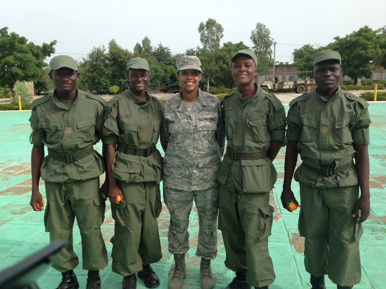 Air Force Master Sgt. Zakiya Taylor of the Kentucky Air National Guard's 123rd Airlift Wing poses with African military cadets while serving as a cadre leader for U.S. Army Cadets participating in the U.S. Army Cadet Command's Cultural Understanding and Language Proficiency Program in Burkina Faso in June 2014. The program strengthens cultural awareness and foreign language proficiency skills among the Army's future leaders. (Courtesy photo)