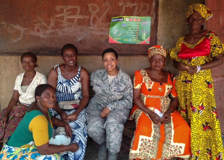 Air Force Master Sgt. Zakiya Taylor of the Kentucky Air National Guard's 123rd Airlift Wing meets with Burkinabe businesswomen while serving as a cadre leader for U.S. Army Cadets participating in the U.S. Army Cadet Command's Cultural Understanding and Language Proficiency Program in Burkina Faso in June 2014. The program strengthens cultural awareness and foreign language skills among the Army's future leaders. (Courtesy photo)