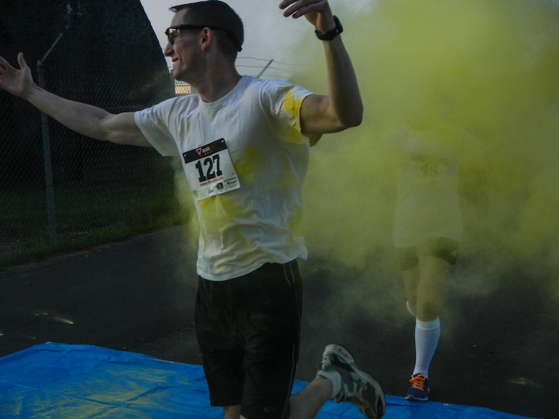 A color run participant is showered in color Aug. 21, 2014, during the Diversity Day 5K Color Run at Spangdahlem Air Base, Germany. Diversity Day held several events on base to highlight different cultures that are in the air force. (U.S. Air Force photo by Staff Sgt. Christopher Ruano/Released)