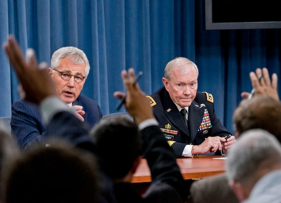 Defense Secretary Chuck Hagel and Army Gen. Martin E. Dempsey, chairman of the Joint Chiefs of Staff, brief reporters at the Pentagon, Aug. 21, 2014. DOD photo by U.S. Army Staff Sgt. Sean K. Harp