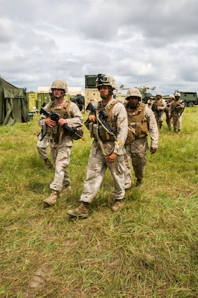 Marines patrol during a base recovery after attack exercise as part of field exercise 2-14 at Ft. Stewart in Hinesville, Ga. The field exercise is conducted to get Marines and sailors tactically ready  with weapon familiarization, performing land navigation, and  living in the field, and gives them a chance to execute their Military Occupational Specialties in the field.