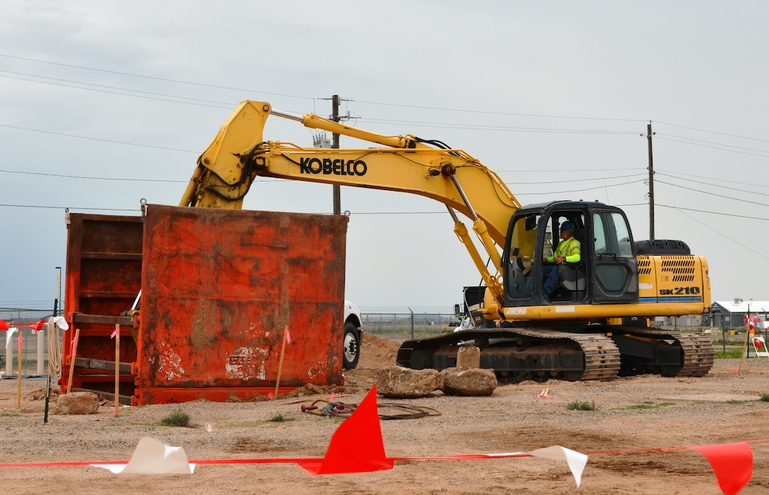 ALBUQUERQUE, N.M., -- Construction workers for CB&I excavate contaminated soils from the Former Fuels Off-Loading Rack area at Kirtland Air Force Base, Aug. 7, 2014.