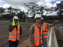 SCHOFIELD BARRACKS, Hawaii (July 29, 2014) --Cadet Kyle Underwood (center), Honolulu District Construction Control Representative Daniel Wong (left), and Project Engineer Randy Itamoto discuss features of the Central Vehicle Wash Facility Project on Schofield Barracks. Underwood is a West Point Cadet. He came to the Honolulu District this summer for the Cadet District Engineer Program. This program allows West Point and ROTC Cadets an opportunity to gain first-hand experience with construction and engineering in the U.S. Army Corps of Engineers. Cadets are typically assigned for one month of training at Corps Districts to assist work on military construction, civil, mechanical, electrical, or environmental engineering projects. The program provides them exposure to the Corps' mission and enables them to explore potential active duty opportunities within the U.S. Army Engineer Branch profession.