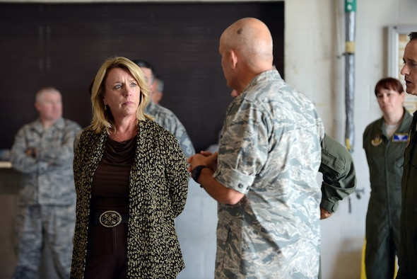 Secretary of the Air Force Deborah Lee James receives a briefing from Col. Kelly Scott Aug. 21, 2014, during a tour of the 461st and 116th Air Control Wings at Robins Air Force Base, Ga. During her tour of Robins Air Force Base, James also visited Air Force Reserve Command, the 78th Air Base Wing and the Warner Robins Air Logistics Complex. Scott is the 461st Maintenance Group commander. (U.S. Air Force photo/Tommie Horton)