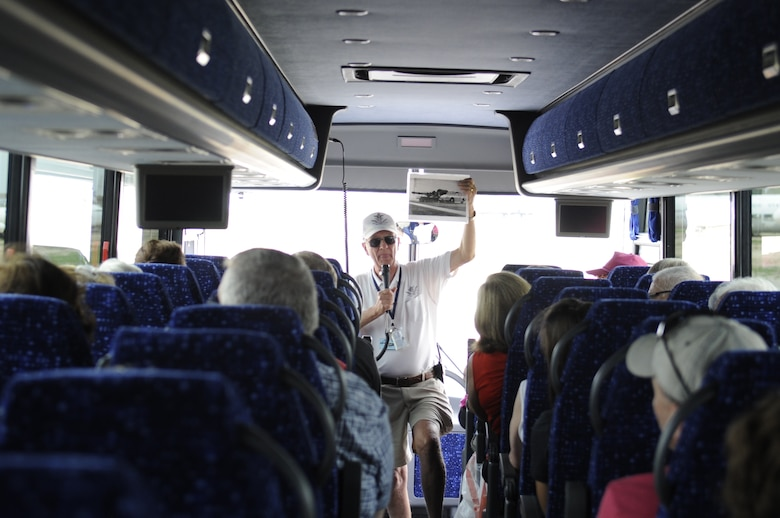 Robert Robuck, Pima Air and Space Museum tour guide, holds up a photo while going over history of the A-10 Thunderbolt during a 309th Aerospace Maintenance and Regeneration Group bus tour, on Davis-Monthan Air Force Base, Ariz., Aug. 21, 2014. For 15 years, PASM, the base and AMARG have had an agreement which allows the museum to run bus tours Monday through Friday through AMARG, giving guests the chance to see AMARG and the aircraft in a preserved state while learning about their history (U.S. Air Force photo by Airman 1st Class Betty R. Chevalier/Released)