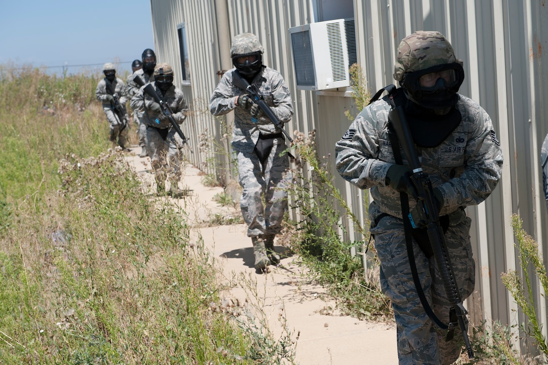 Members of the 460th Operations Group act as opposing forces during a field training exercise as part of the Panther Challenge, designed to allow space operators and 460th Security Forces Squadron members experience in what to do during a crisis situation Aug 11, 2014, on Buckley Air Force Base, Colo. The challenge, held Aug. 4-13, was developed to provide members of Team Buckley an opportunity to improve their skills and expand their job knowledge in a competitive setting. Participants in the challenge included the 2nd and 8th Space Warning Squadrons, 460th Security Forces Squadron, and 460th Medical Group. (U.S. Air Force photo by Senior Airman Phillip Houk/Released)