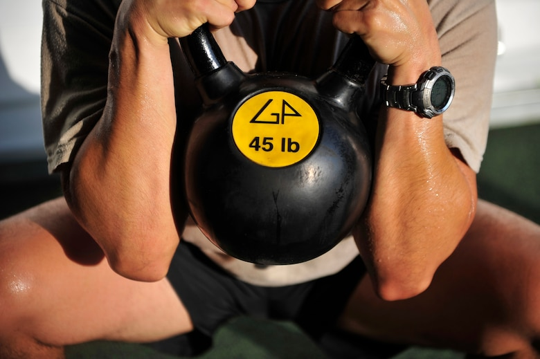 An Airman performs a goblet squat during a functional fitness class at the Aderholt Fitness Center, Hurlburt Field, Fla., Aug. 22, 2014. Fitness instructors taught Airmen to use functional movements to maximize their strength. (U.S. Air Force photo/Staff Sgt. Tyler Placie)