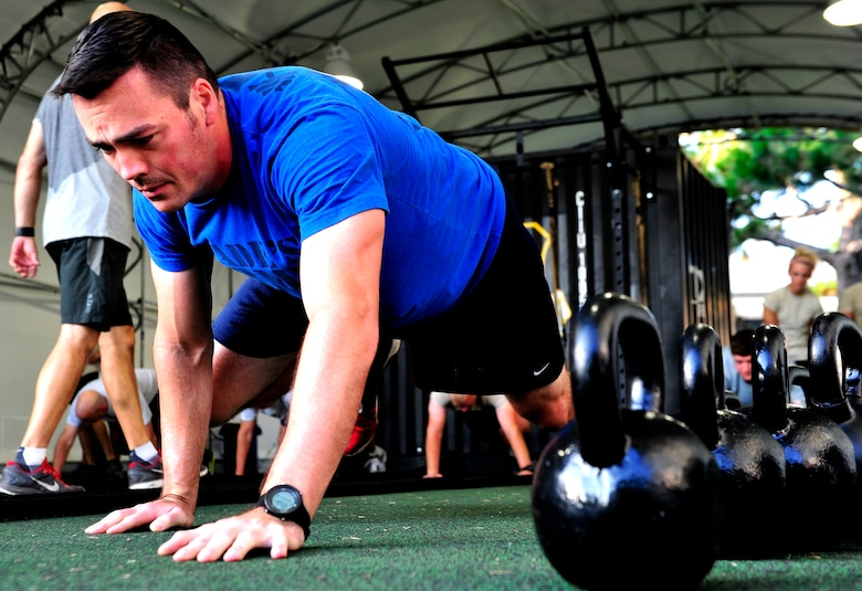 Tech. Sgt. Michael Dylan, 18th Flight Test Squadron, warms up for a functional fitness class at the Aderholt Fitness Center, Hurlburt Field, Fla., Aug. 22, 2014. Fitness instructors taught Airmen to use functional movements to maximize their strength. (U.S. Air Force photo/Staff Sgt. Tyler Placie)