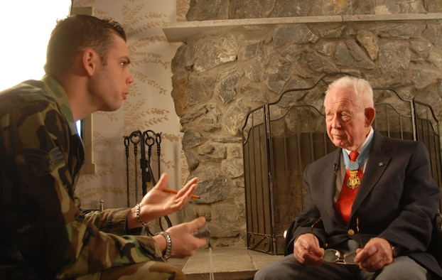 This archived photo shows then-Senior Airman Steven R. Doty, 8th Fighter Wing Public Affairs, interviewing retired Col. Bernard Fisher. Fisher and his wingman, Maj. Wayne Myers, ignored low clouds and repeatedly strafed the enemy with their A-1E Skyraiders. During one pass, Myers' aircraft was hit and caught fire and too low to bailout, Myers crash-landed his aircraft on the small and heavily damaged airstrip at the special forces camp and ran to cover alongside the runway. (U.S. Air Force photo by Staff Sgt. Darcie Ibidapo)(Released)