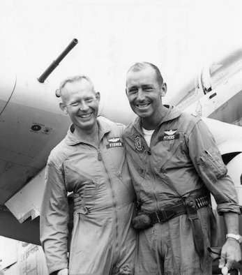 This photo of Maj. Bernard Fisher, left, and Maj. Wayne Myers, was taken in Vietnam, 1966. Fisher and Myers were among a group of pilots strafing enemy positions to protect a camp next to a route used by insurgents flooding into South Vietnam from Laos. Myers' plane was shot down and he was forced to crash-land because he was flying too low to bail out. (U.S. Air Force photo)(Released)