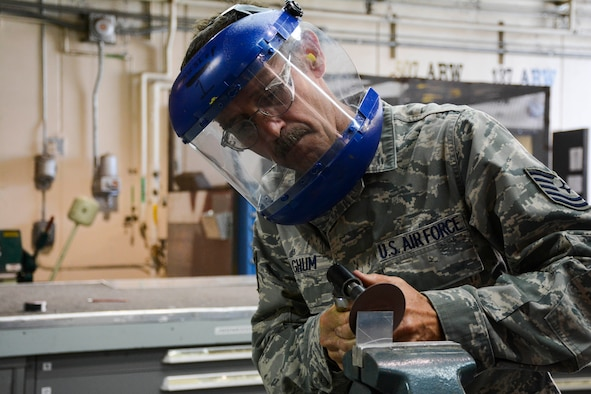 Technical Sergeant Harold Fulghum shapes and grinds a joggle block to be used on the simulated aircraft structure being built by the 507th Air Refueling Wing fabrication flight's sheet metal shop.  Fulghum came up with the idea to build the simulator.  It gives sheet metal workers the opportunity to work on the leading edge of a KC-135R Stratotanker wing without the jet actually being broken.  (U.S. Air Force photo/Senior Airman Mark Hybers)
