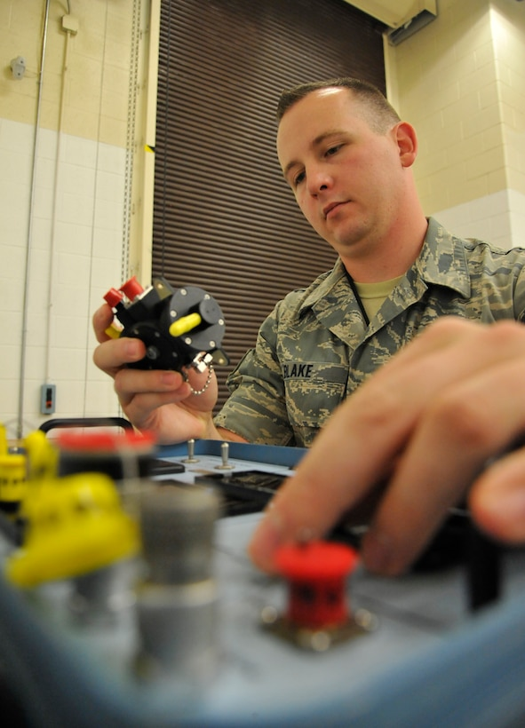 U.S. Air Force Staff Sgt. Paul Blake, 509th Maintenance Squadron egress systems supervisor, performs environmental sensor test Aug. 5, 2014 at Whiteman Air Force Base, Missouri. The environmental sensor is used to accurately read aircraft airspeeds and altitudes. Whiteman's egress shop receives vital assistance multiple units on base including the electrical environmental shop and the aircrew flight equipment shop. (U.S. Air Force photo by Airman 1st Class Keenan Berry/Released)