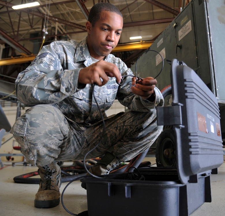 U.S. Air Force Senior Airman Christopher Papa, 509th Maintenance Squadron egress technician, sets communication headsets at Whiteman Air Force Base, Missouri, Aug. 12, 2014. The 509th Maintenance Squadron's egress shop maintain the B-2s' egress systems, ensuring they function properly for pilot safety. (U.S. Air Force photo by Airman 1st Class Keenan Berry/Released)