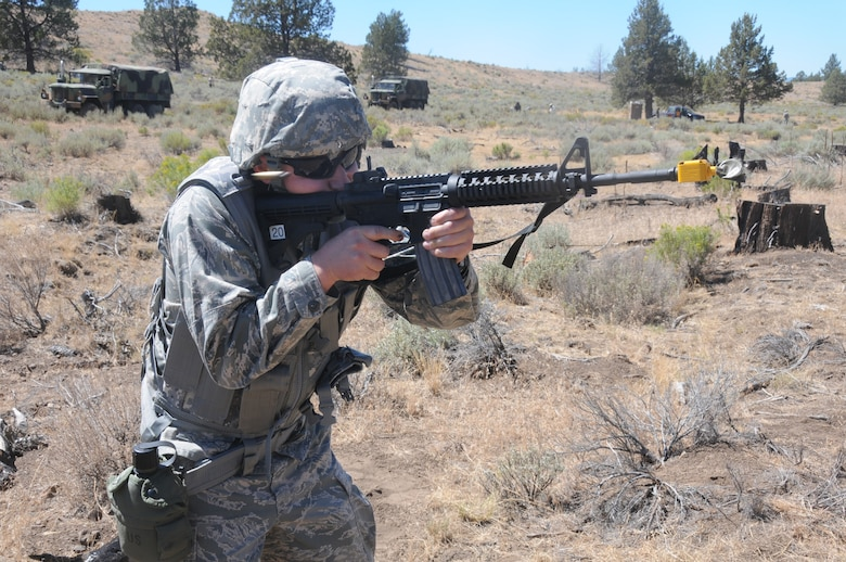 U.S. Air Force 1st Lt. Daniel Dierickx of the 270th Air Traffic Control Squadron fires blanks after completing an exercise to hone base defense skills near Bonanza, Oregon on public land, July 26, 2014. The 270th Air Traffic Control Squadron controls the airspace for the 173rd Fighter Wing as well as civilian aircraft at Kingsley Field but also has an expeditionary tasking. This year's annual training emphasized that capability and involved several exercises off base. (U.S. Air National Guard photo by Tech. Sgt. Jefferson Thompson/Released)