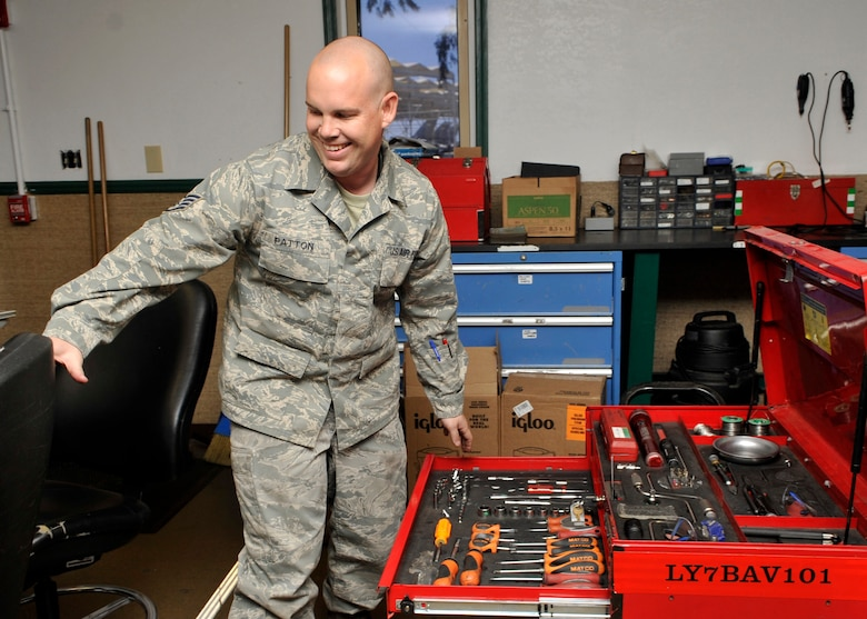 Staff Sgt. David Patton, 56th Aircraft Maintenance Squadron support section floor chief, repairs a tool box Aug. 6 on Luke Air Force Base. Patton administered life-saving CPR to Robert Clark and received an award from Mayor Sharon Wolcott of Surprise and the Surprise Fire and Paramedic Departments. (U.S. Air Force photo/Senior Airman Marcy Copeland)