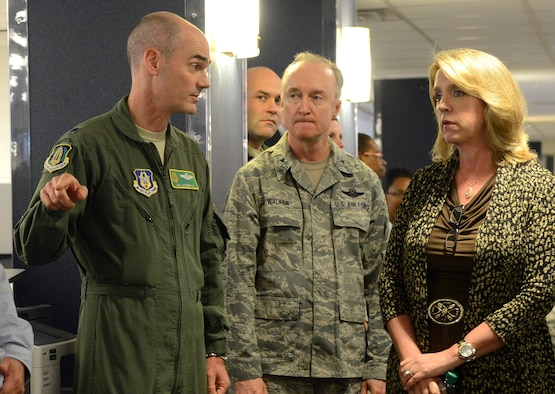 Lt. Col. Bill Gutermuth, Air Force Reserve Command, left, briefs Secretary of the Air Force Deborah Lee James as Brig. Gen. Edmund D. Walker, Force Generation Center commander, listens during her visit to the FGC in Bldg. 210 at Robins Air Force Base, Georgia. Aug. 21, 2014. The center ensures real-time visibility, accountability and long-range planning for reserve forces which provides Reservists greater predictability in their deployment schedules.  (U.S. Air Force photo by Tommie Horton)