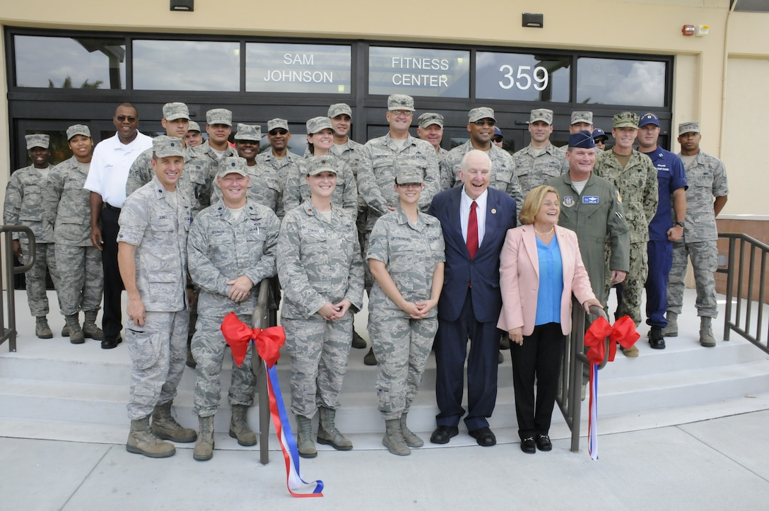 Members from Homestead Air Reserve Base gather together around the newly renovated Sam Johnson Fitness Center. Congressman Sam Johnson, representing the 3rd District of Texas, came to the base for the ribbon cutting of the fitness center, which is named after the congressman Aug. 20. Congresswoman Ileana Ros-Lehtinen, representing Florida's 27th Congressional District, also attended the ribbon cutting events. (Air Force photo/Senior Airman Nicolas Caceres)