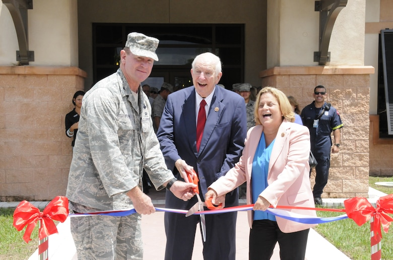 Congressman Sam Johnson, representing the 3rd District of Texas, Congresswoman Ileana Ros-Lehtinen, representing Florida's 27th Congressional District, and Col. Chris Funk, 482nd Fighter Wing commander, cut the ribbon on the new Community Activity Center. Two brand-new facilities and the newly renovated Sam Johnson Fitness Center were officially opened during a ribbon cutting event Aug. 20 at Homestead Air Reserve Base. (Air Force photo/Senior Airman Nicolas Caceres)