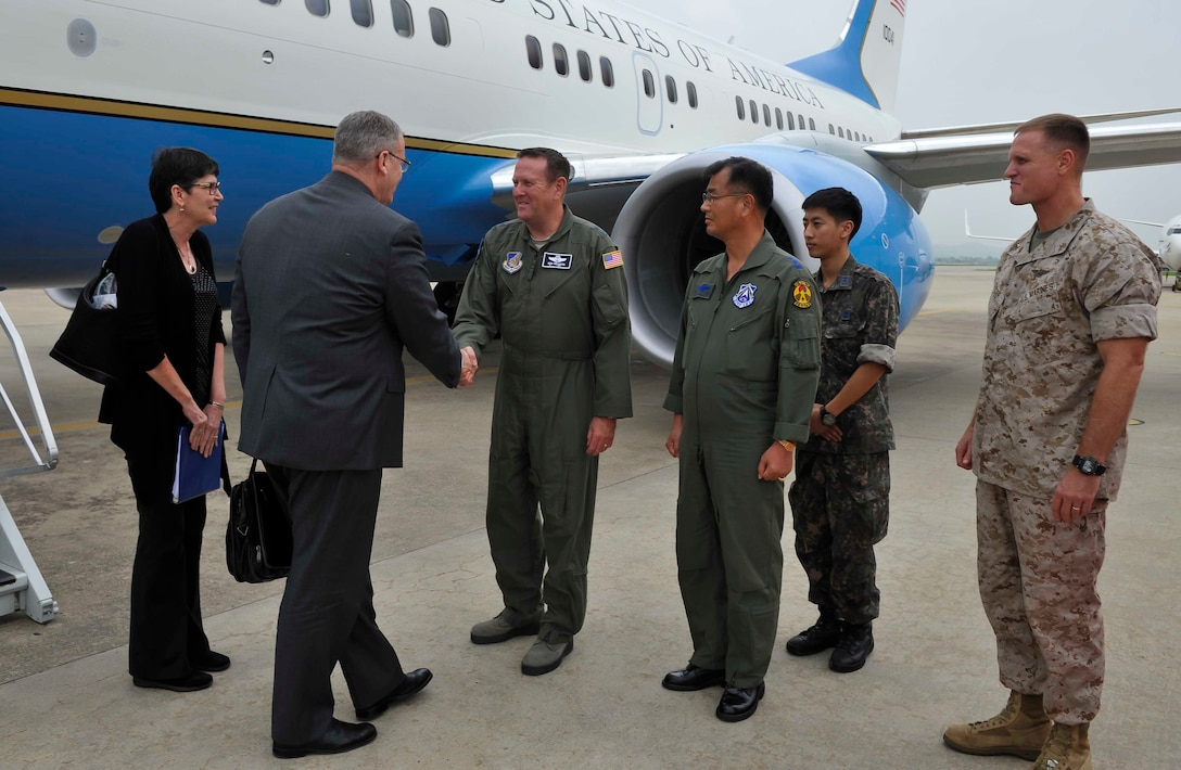 Deputy Secretary of Defense Bob Work is greeted by Maj. Gen. Robert Millmann Jr., 7th Air Force mobilization assistant to the commander, during his visit to Osan Air Base, Republic of Korea, Aug. 20, 2014. Work met with political leaders on the first day of his two-day visit. (U.S. Air Force photo/Senior Airman David Owsianka)