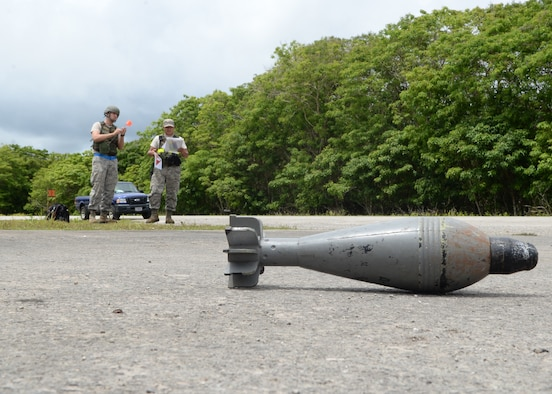 Senior Airman Jesus Babauta, and Airman 1st Class Brandon Levulis, both with the 36th Munitions Squadron munitions storage area, identify a simulated unexploded ordnance during Exercise Beverly Palm 14-04 Aug. 20, 2014, on Andersen Air Force Base, Guam. The 12-hour exercise took place to enhance the skills of Airmen in preparation for real-world contingencies. (U.S. Air Force photo by Airman 1st Class Amanda Morris/Released)