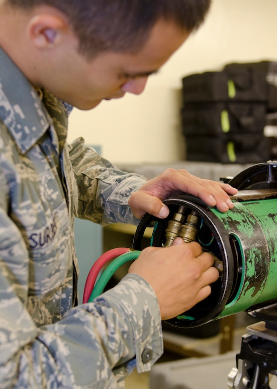 Airman 1st Class Ashton Surber, 36th Maintenance Squadron non-destructive inspection journeyman, adjusts a radiographic machine Aug. 21, 2014, on Andersen Air Force Base, Guam. NDI Airmen detect flaws using penetrant, magnetic particle, radiographic, optical and ultrasonic test equipment. (U.S. Air Force photo by Senior Airman Katrina M. Brisbin/Released)