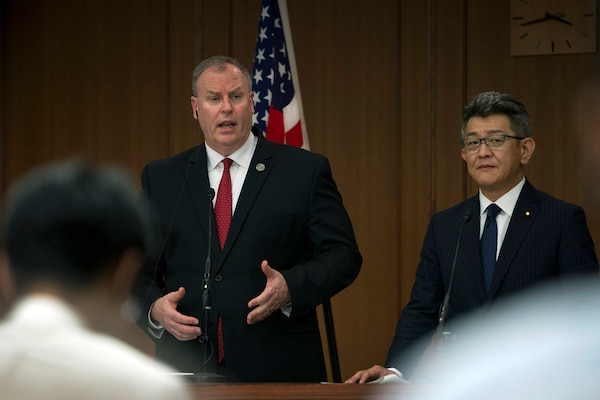 U.S. Deputy Defense Secretary Bob Work, left, and Japanese Senior Vice Defense Minister Ryota Takeda answer questions about U.S. and Japanese partnerships and how to bolster security and stability in the Asia-Pacific region during a press conference in Tokyo, Aug. 22, 2014. DoD photo by U.S. Air Force Master Sgt. Adrian Cadiz