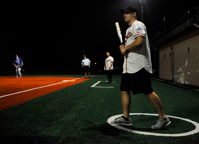 John Jenkins, 51st Operations Support Squadron, walks to the plate during the fifth inning of the intramural softball championship game on Osan Air Base, Republic of Korea, Aug. 21, 2014. Jenkins grounded out during his at bat. (U.S. Air Force photo/Senior Airman David Owsianka)