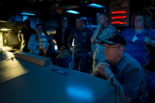 Deputy Defense Secretary Bob Work is briefed on the capabilities of the USS Shiloh during a tour of the Ticonderoga-class guided missile cruiser at Fleet Activities Yokosuka, Japan, during his first official visit to the Asia-Pacific region Aug. 23, 2014. DoD Photo by Air Force Master Sgt. Adrian Cadiz