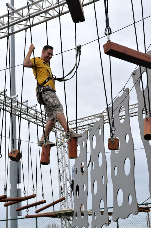 Airman 1st Class James Ramroth, 460th Operations Group satellite technician, balances his way through obstacles during FunFest Aug. 22, 2014 on Buckley Air Force Base, Colo. The 460th Space Wing celebrated its 10th birthday with FunFest, a day filled with sport competitions and a community fair. (U.S. Air Force photo by Airman Emily E. Amyotte/Released)