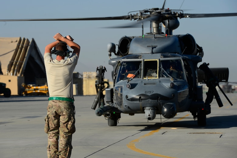 U.S. Air Force Senior Airman Trevor Eastlick, 455th Expeditionary Aircraft Maintenance Squadron crew chief, marshals in a HH-60G Pave Hawk after conducting mission rehearsals at Bagram Air Field, Afghanistan, July 19, 2014. Eastlick is an Etna, Calif. native deployed from the 923rd Aircraft Maintenance Squadron, Davis-Monthan Air Force Base, Ariz. (U.S. Air Force photo by Senior Airman Sandra Welch)