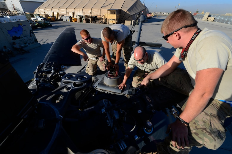 Airmen from the 455th Expeditionary Aircraft Maintenance Squadron perform a preflight inspection on a HH-60G Pave Hawk at Bagram Air Field, Afghanistan, July 19, 2014. The team is deployed from the 923rd Aircraft Maintenance Squadron, Davis-Monthan Air Force Base, Ariz. (U.S. Air Force photo by Senior Airman Sandra Welch) (U.S. Air Force photo by Senior Airman Sandra Welch)