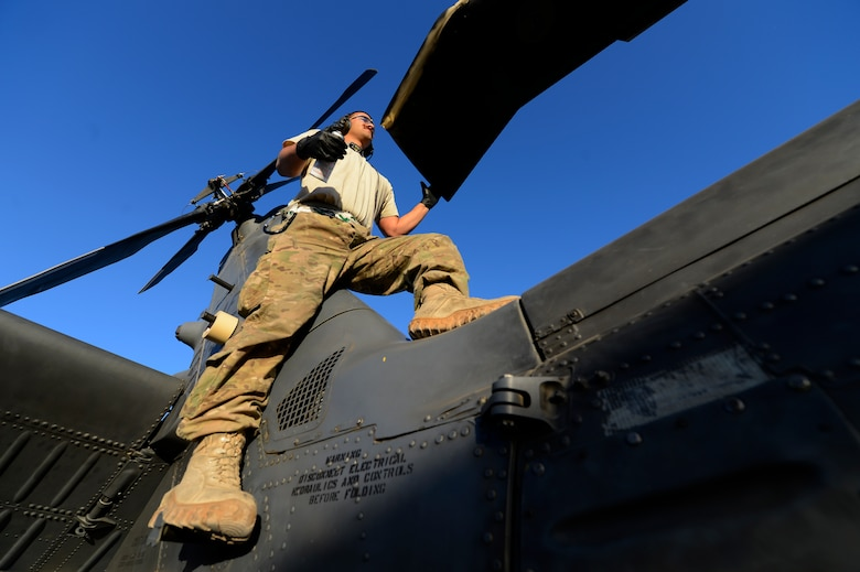 U.S. Air Force Staff Sgt. Richard Eady, 455th Expeditionary Aircraft Maintenance Squadron crew chief, conducts a preflight inspection on a HH-60G Pave Hawk at Bagram Air Field, Afghanistan, July 19, 2014. These inspections are conducted every 72 hours. Eady is a Pittsburgh, Pa., native deployed from the 923rd Aircraft Maintenance Squadron, Davis-Monthan Air Force Base, Ariz. (U.S. Air Force photo by Senior Airman Sandra Welch)