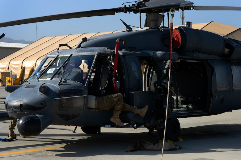 Airmen from the 455th Expeditionary Aircraft Maintenance Squadron conduct a preflight inspection on an HH-60G Pave Hawk helicopter at Bagram Air Field, Afghanistan, July 10, 2014. The maintenance team is deployed from the 923rd Aircraft Maintenance Squadron, Davis-Monthan Air Force Base, Arizona. (U.S. Air Force photo by Senior Airman Sandra Welch/Released)