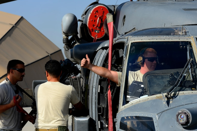 Senior Airman Benjamin Martin, 455th Expeditionary Aircraft Maintenance Squadron crew chief, gives a thumbs-up during a preflight inspection on an HH-60G Pave Hawk helicopter at Bagram Air Field, Afghanistan, July 10, 2014. Martin, a Colorado Springs, Colorado native, is deployed from the 923rd Aircraft Maintenance Squadron, Davis-Monthan Air Force Base, Arizona. (U.S. Air Force photo by Senior Airman Sandra Welch/Released)