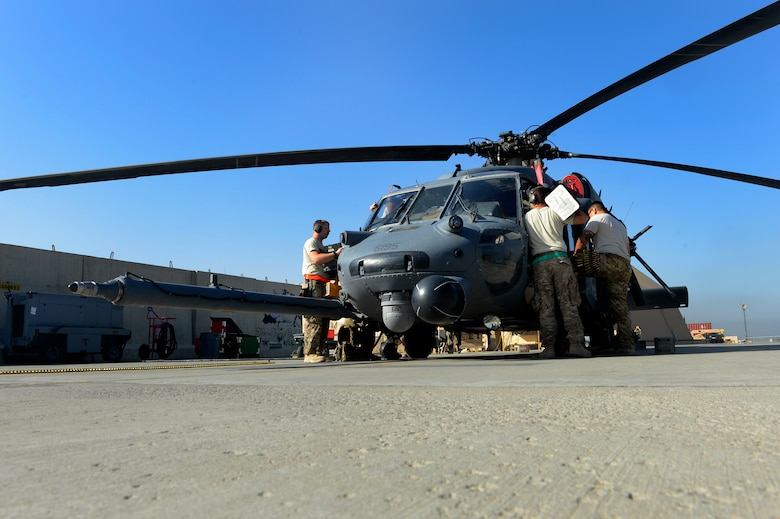 Airmen from the 455th Expeditionary Aircraft Maintenance Squadron conduct a pre-flight inspection on an HH-60G Pave Hawk helicopter at Bagram Air Field, Afghanistan, July 10, 2014. The maintenance team is deployed from the 923rd Aircraft Maintenance Squadron, Davis-Monthan Air Force Base, Arizona. (U.S. Air Force photo by Senior Airman Sandra Welch/Released)