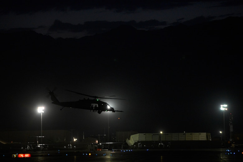 A Pararescue team takes off from Bagram Air Field Afghanistan, July 9, 2014 in an HH-60G Pave Hawk helicopter. Air Force PJs are the only DoD elite combat forces specifically organized, trained, equipped, and postured to conduct full spectrum Personnel Recovery to include both conventional and unconventional combat rescue operations. (U.S. Air Force photo by Senior Airman Sandra Welch/Released)
