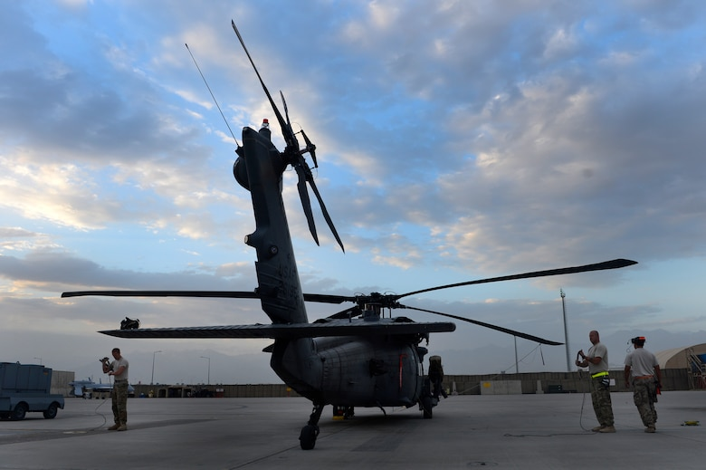 Airmen from the 455th Expeditionary Aircraft Maintenance Squadron prep an HH-60G Pave Hawk helicopter for flight at Bagram Air Field, Afghanistan, July 9, 2014. The maintenance team is deployed from the 923rd Aircraft Maintenance Squadron, Davis-Monthan Air Force Base, Arizona. (U.S. Air Force photo by Senior Airman Sandra Welch/Released)