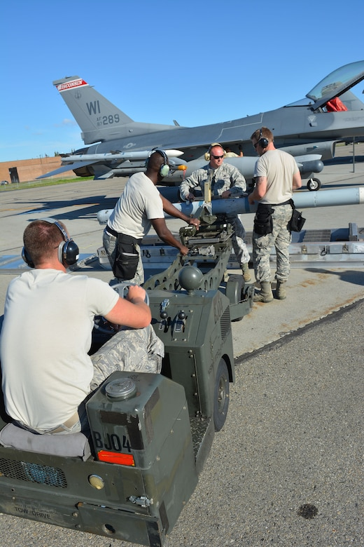 Airmen prepare to load an F-16 Fighting Falcon from the 115th Fighter Wing in Madison, Wis., during the RED FLAG-Alaska exercise at Eielson Air Force Base, Alaska, Aug. 12, 2014. Approximately 130 Airmen from the 115 FW participated in the event, refreshing skills and working in real-world scenarios to test their combat abilities in a high-paced environment. (Air National Guard photo by Staff Sgt. Ryan Roth)