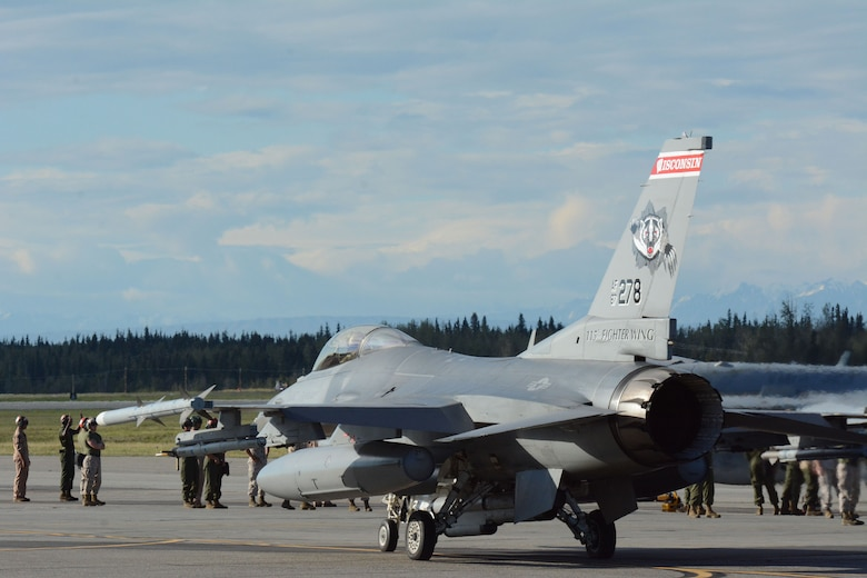 Airmen surround an F-16 Fighting Falcon from the 115th Fighter Wing in Madison, Wis., during the RED FLAG-Alaska exercise at Eielson Air Force Base, Alaska, Aug. 11, 2014. Approximately 130 Airmen from the 115 FW participated in the event, refreshing skills and working in real-world scenarios to test their combat abilities in a high-paced environment. (Air National Guard photo by Staff Sgt. Ryan Roth)
